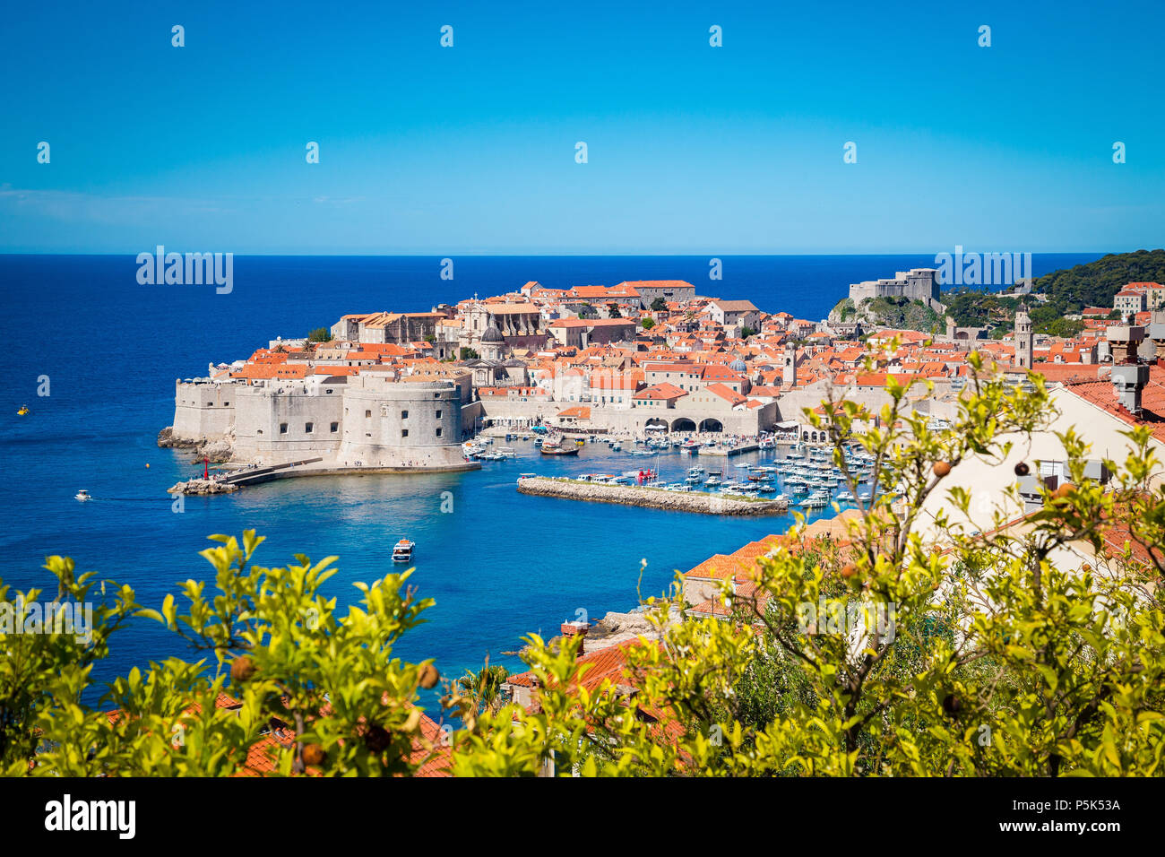 Panoramic aerial view of the historic town of Dubrovnik, one of the most famous tourist destinations in the Mediterranean Sea, from Srt mountain on a  - Stock Image