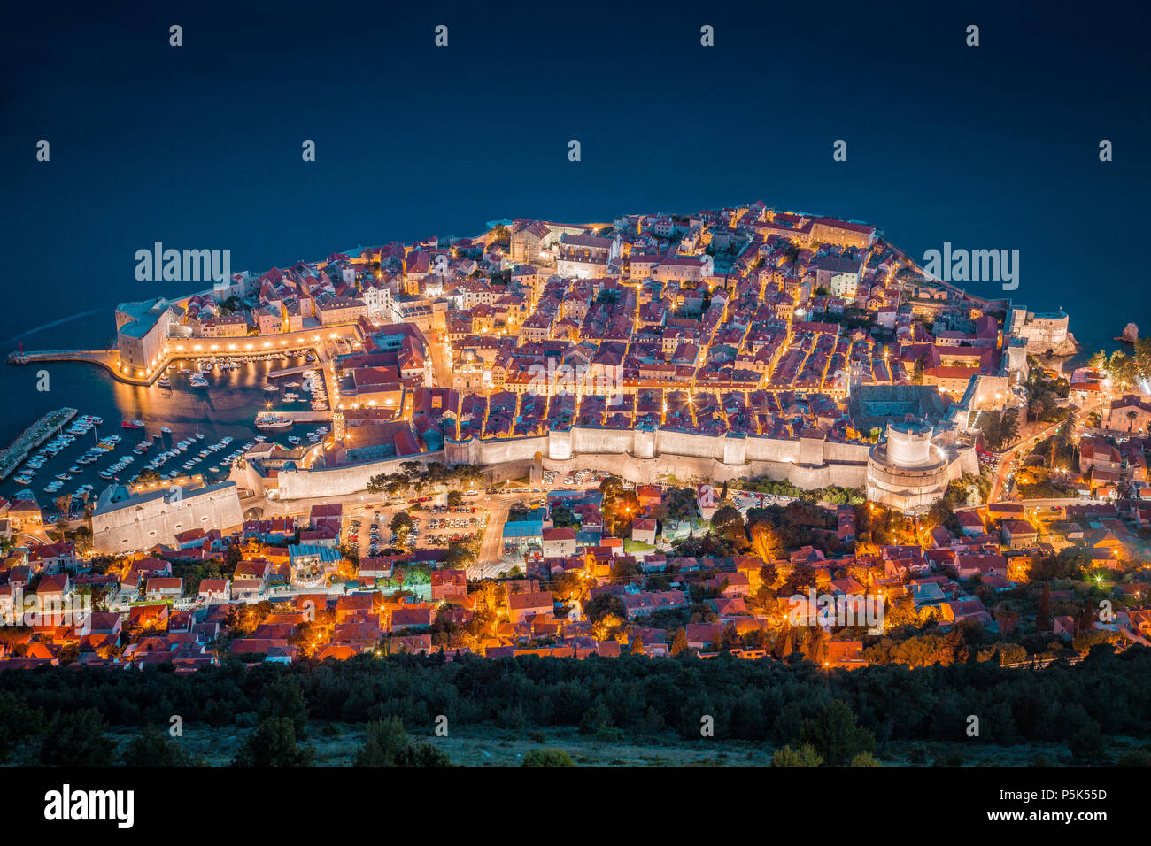 Panoramic aerial view of the historic town of Dubrovnik, one of the most famous tourist destinations in the Mediterranean Sea, in beautiful evening tw - Stock Image