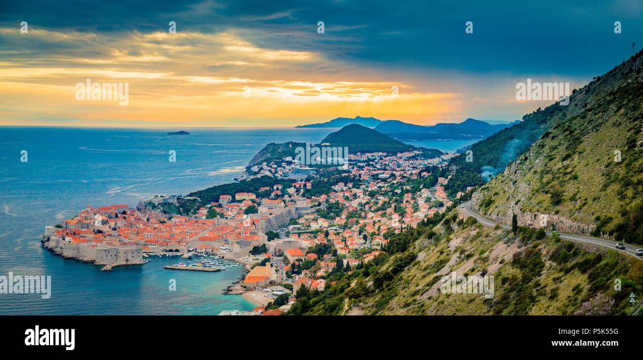 Panoramic aerial view of the historic town of Dubrovnik, one of the most famous tourist destinations in the Mediterranean Sea, in beautiful golden eve - Stock Image