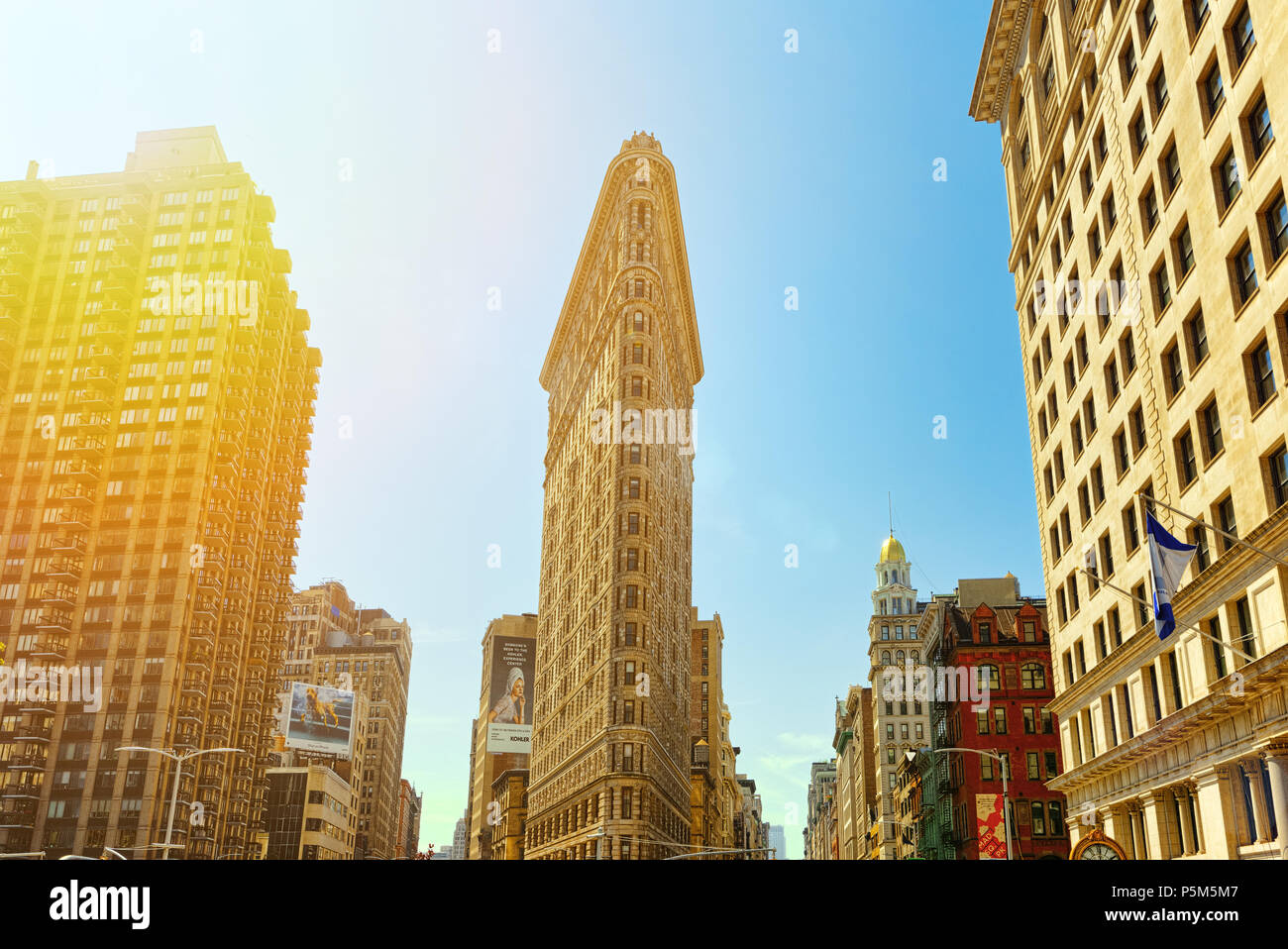 New York, USA- August 14, 2017 : Flatiron Building on 5th Avenue near Madison Square Park. Urban views of New York. Street, people and tourists on it. - Stock Image
