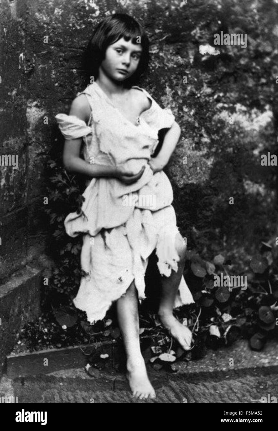 N/A. English: Alice Liddell as a beggar-maid (from the story of Cophetua). Supposed tear hole or ink-blot in photo digitally removed. This was first published in Carroll's biography by his nephew: Collingwood, Stuart Dodgson (1898) The Life and Letters of Lewis Carroll, London: T. Fisher Unwin, pp.p. 80 Retrieved on 22 December 2010. . 1858.   Lewis Carroll (1832–1898)   Alternative names Charles Lutwidge Dodgson  Description British-English writer, mathematician and photographer  Date of birth/death 27 January 1832 14 January 1898  Location of birth/death Daresbury, Cheshire, England Gu - Stock Image