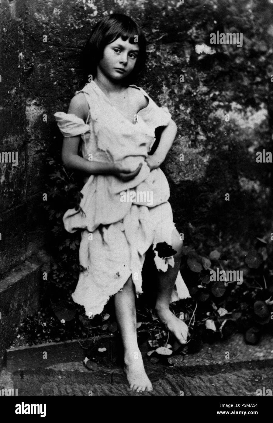 N/A. English: Alice Liddell as a beggar girl. Photo by Lewis Carroll. High resolution: This was first published in Carroll's biography by his nephew: Collingwood, Stuart Dodgson (1898) The Life and Letters of Lewis Carroll, London: T. Fisher Unwin, pp.p. 80 Retrieved on 22 December 2010. . 1858.   Lewis Carroll (1832–1898)   Alternative names Charles Lutwidge Dodgson  Description British-English writer, mathematician and photographer  Date of birth/death 27 January 1832 14 January 1898  Location of birth/death Daresbury, Cheshire, England Guildford, Surrey, England  Work period 1854 to 1 - Stock Image