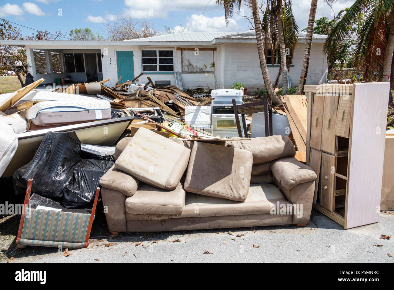 Everglades City Florida after Hurricane Irma houses homes residences front yard storm disaster recovery cleanup flood surge damage destruction afterma - Stock Image