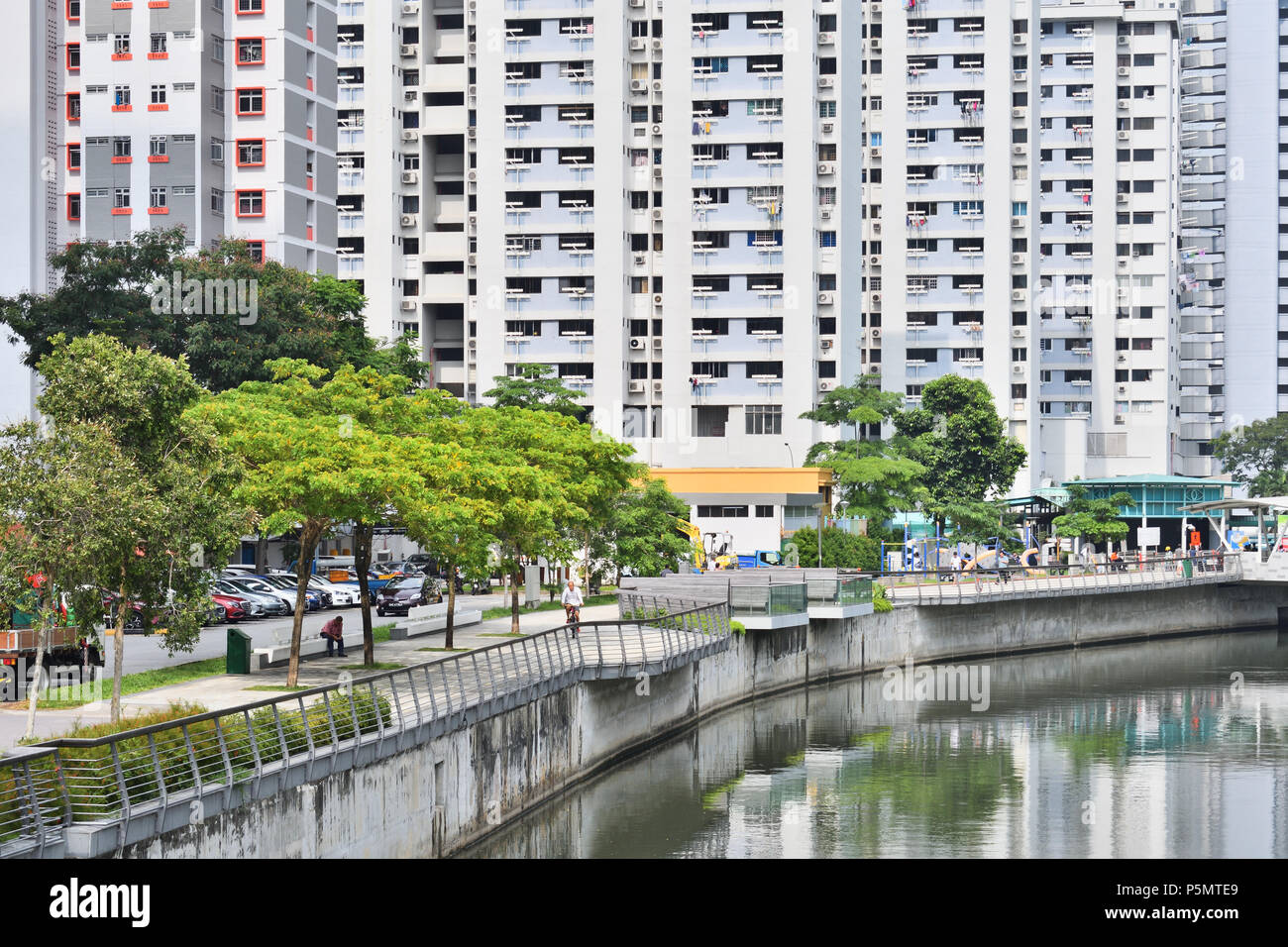 A residential area along the Rochor Canal and North Bridge Road. This looks at government-subsidized 'public housing' HDB flats in a heartland. - Stock Image