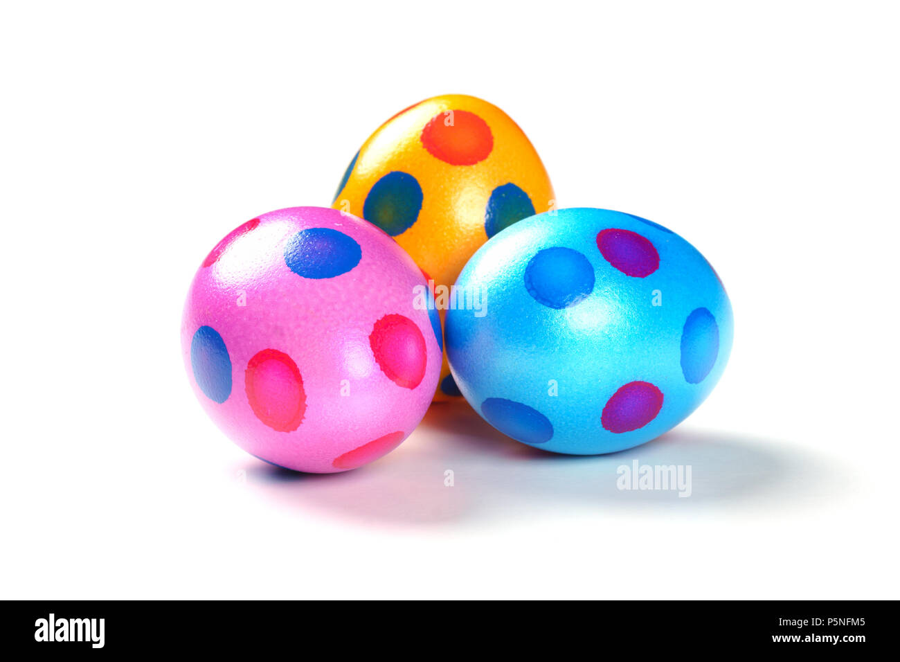 Three colorful Easter Eggs with dots on white Background - Isolated. - Stock Image