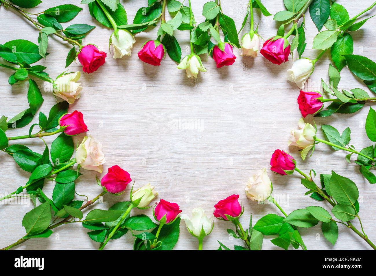 Heart From Pink And White Rose Flowers On Rustic Table For March 8