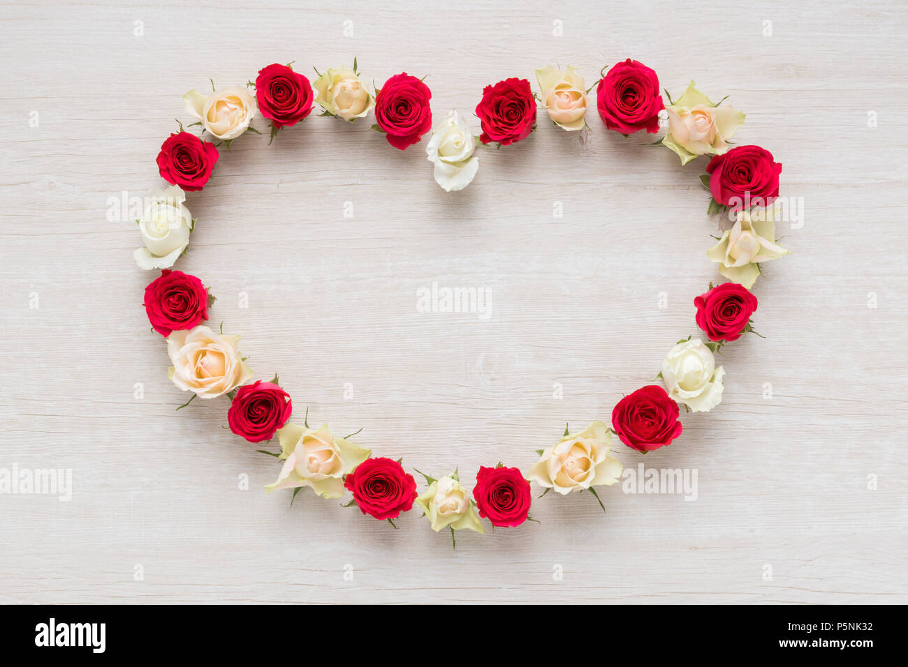 Heart From Red And White Rose Flowers On Rustic Table For March 8