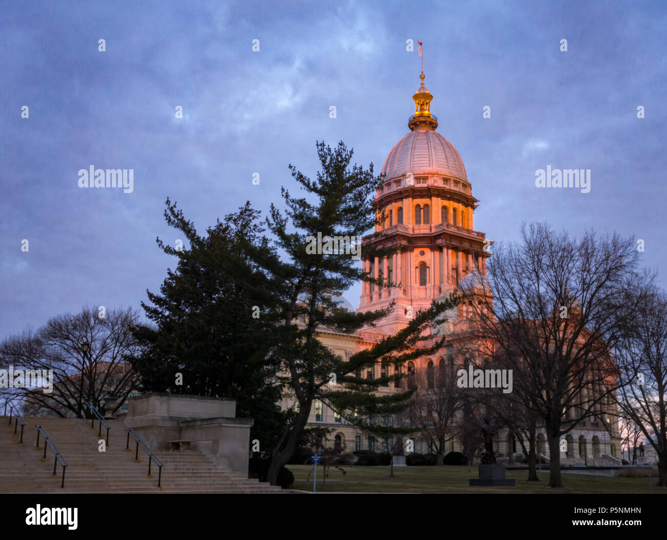 Illinois State Capitol building at sunrise with trees in Springfield Illinois - Stock Image