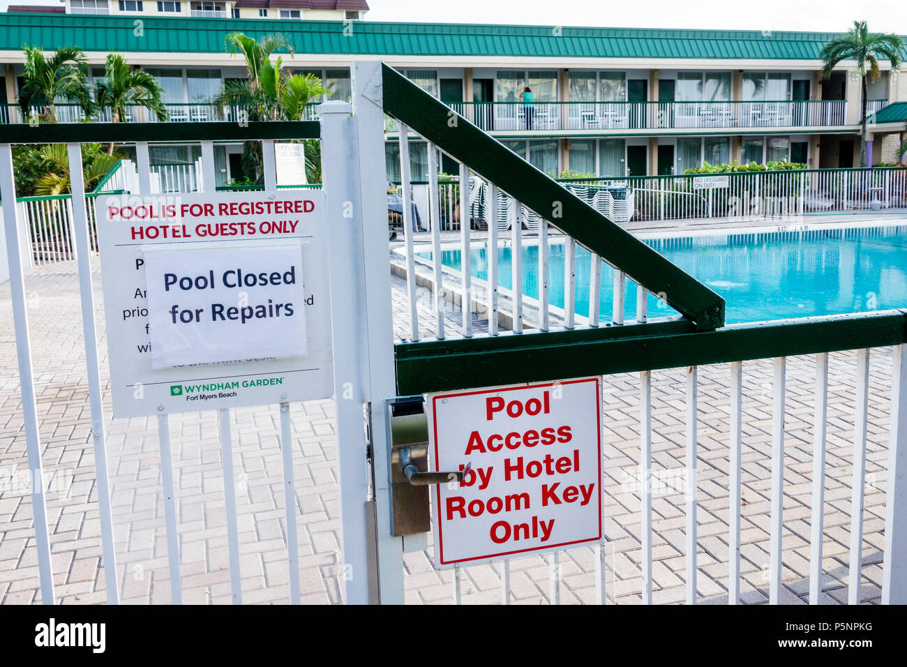 Fort Ft. Myers Florida Beach Wyndham Garden hotel resort swimming pool closed repairs restricted access fence - Stock Image