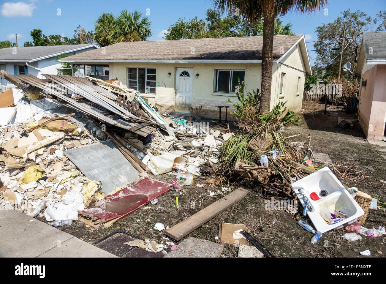 Bonita Springs Florida after Hurricane Irma storm water damage destruction aftermath flooding house home front yard debris trash pile flood depth wate - Stock Image