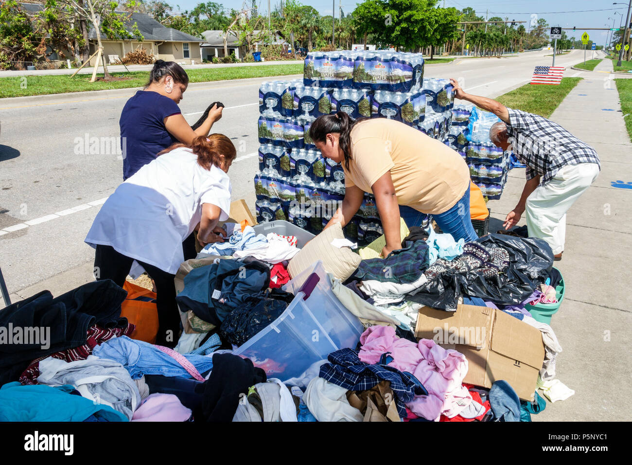 Bonita Springs Florida after Hurricane Irma storm damage destruction aftermath disaster relief recovery donations distribution site point Hispanic wom - Stock Image