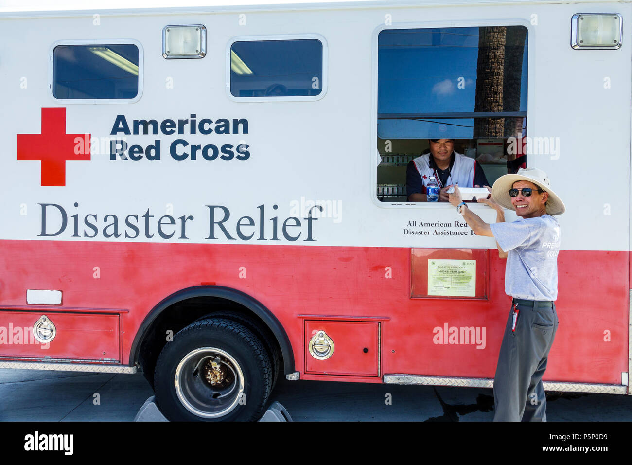 Bonita Springs Florida after Hurricane Irma storm damage destruction aftermath disaster recovery relief donations distribution site point Red Cross Di - Stock Image