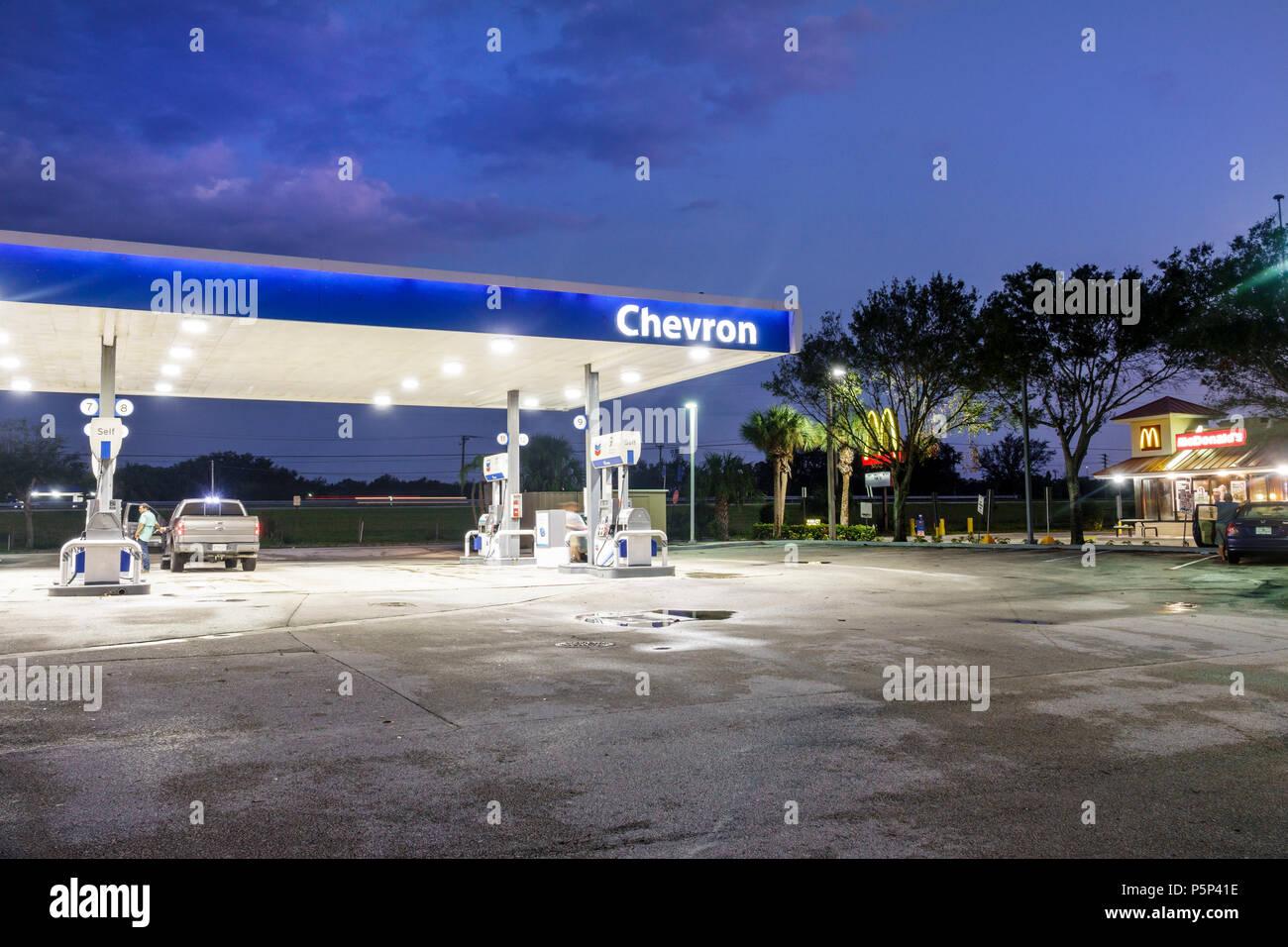 Stuart Florida night Chevron gas petrol filling fueling station pumps canopy - Stock Image