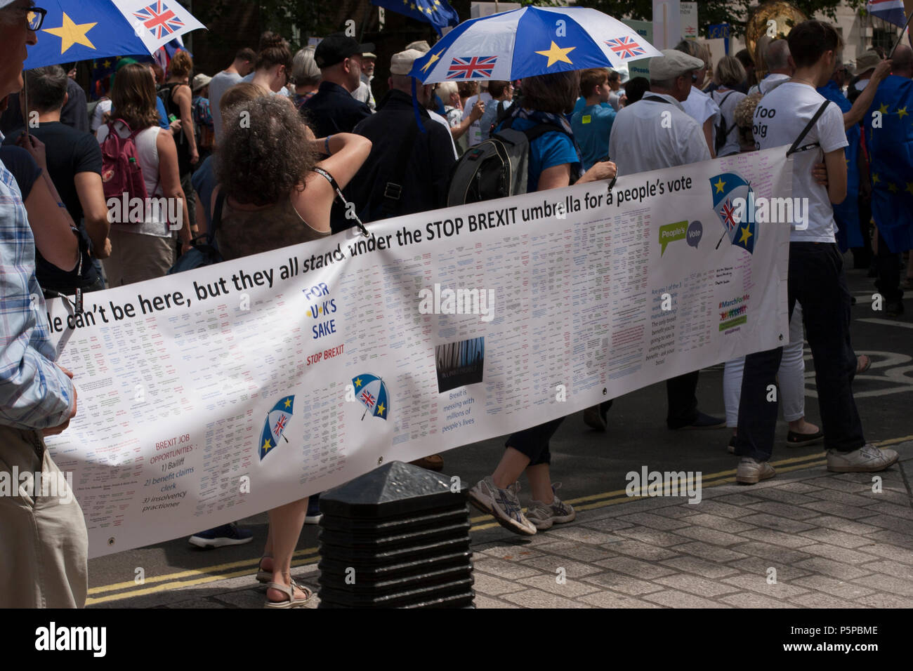 People's Vote March, London, UK, 23rd June 2018. Banner: We can't be here, but they all stand under the STOP BREXIT umbrella #MarchForMe - Stock Image