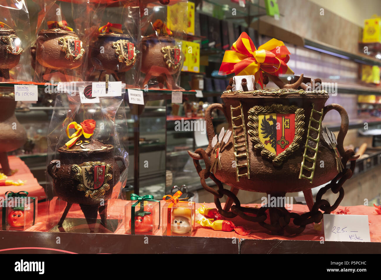 Geneva, Switzerland - November 24, 2016: window of chocolate shop in Geneva selling large marmites filled with marzipan vegetables and candies wrapped Stock Photo