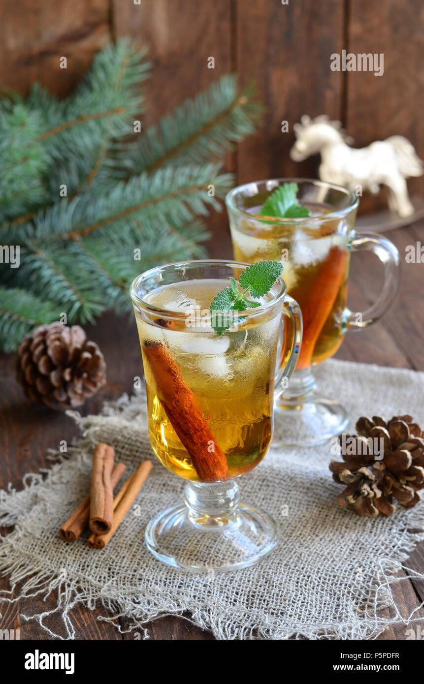 Whiskey cocktail with cinnamon on Christmas background - Stock Image