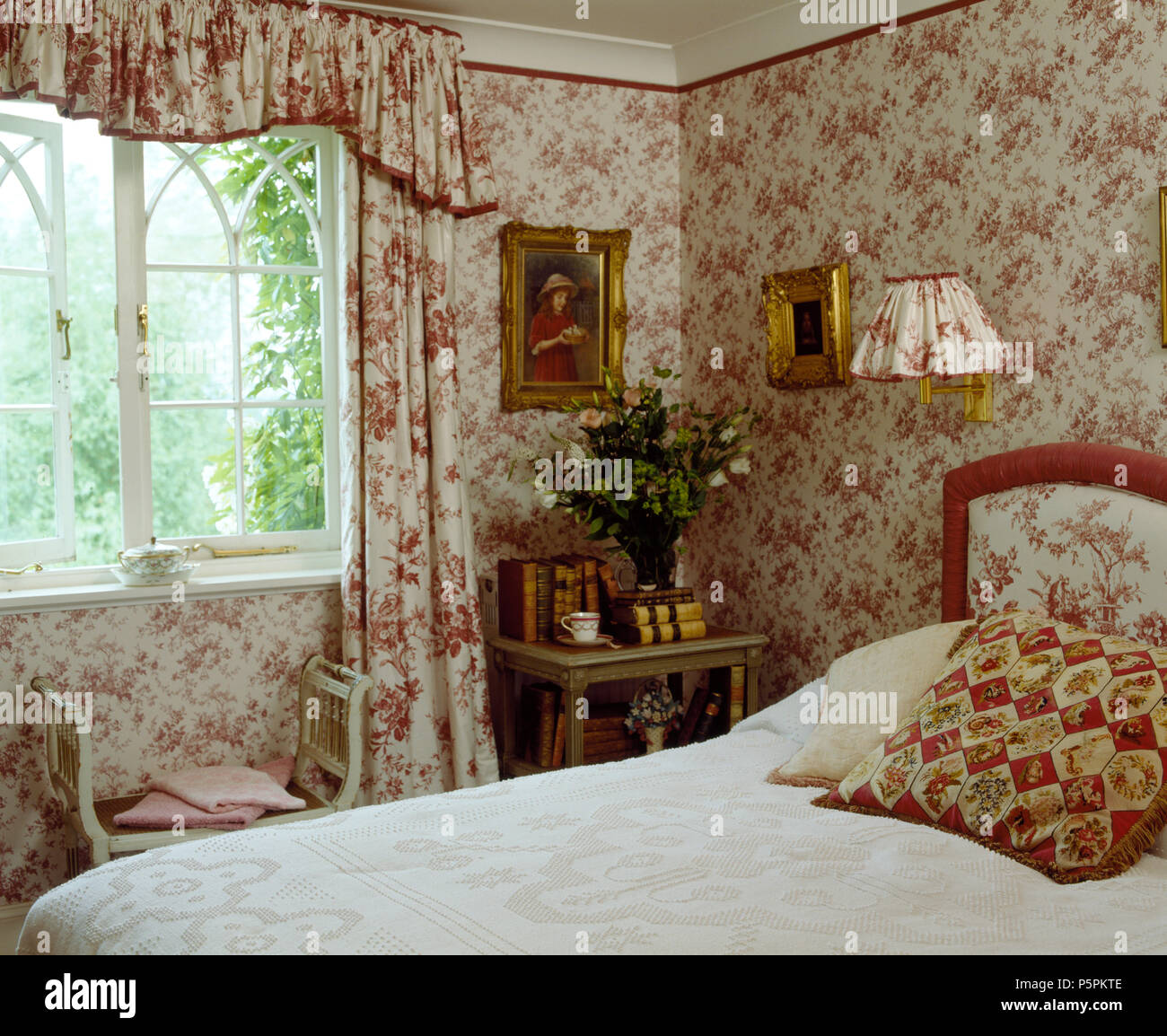Co Ordinating Floral Wallpaper And Curtains In Country Bedroom With