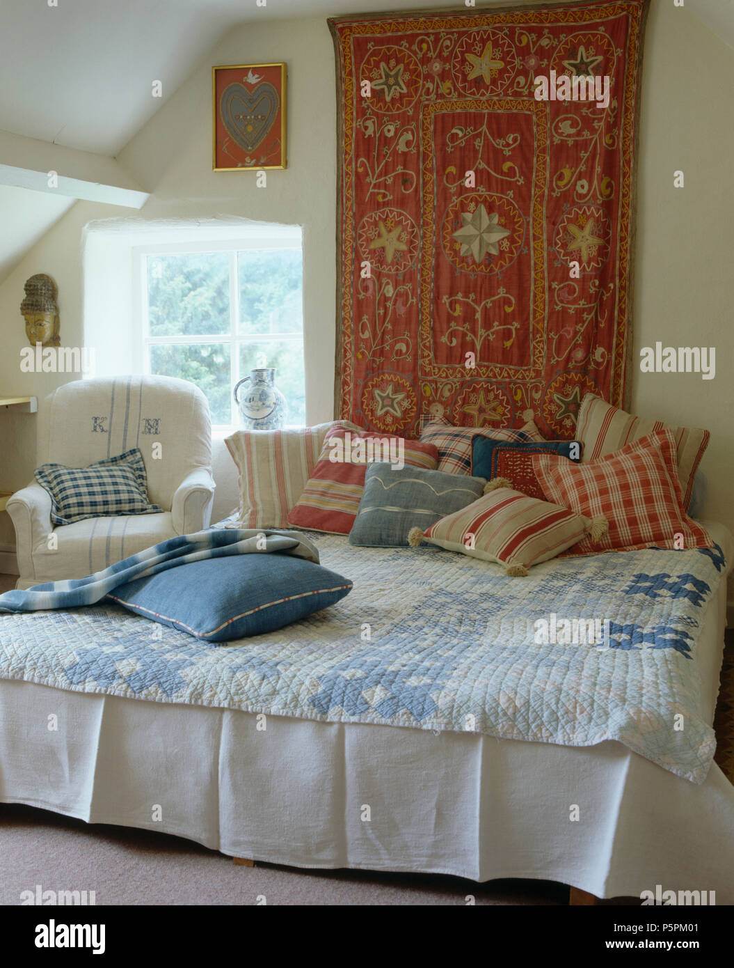 Country Bedroom Indian Style Wall Hanging Above Bed Piled With Red