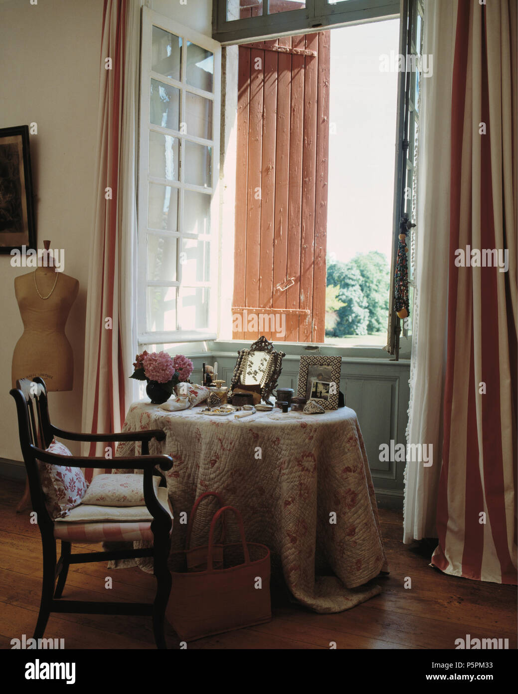 Quilted Cloth On Circular Table In Front Of Open Window With