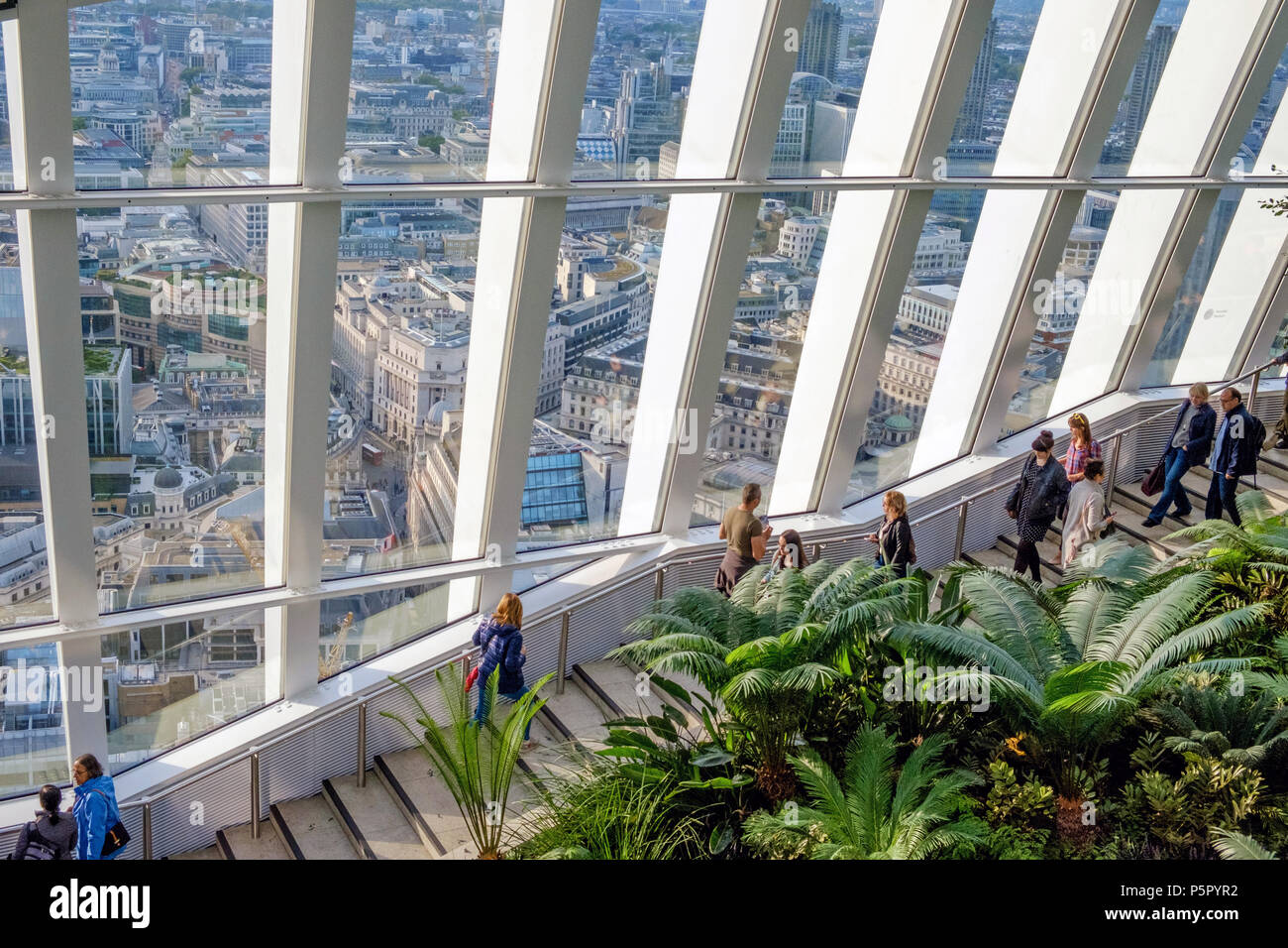 View of London through large windows from the Sky Garden, 20 Fenchurch St. London's Highest Public Garden. Known as the Walkie Talkie. Horizontal. - Stock Image