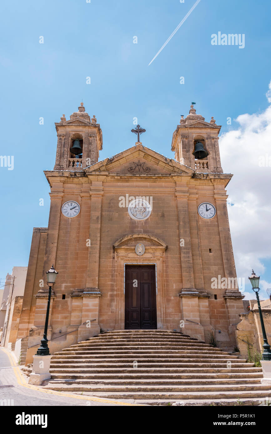Ghajnsielem old parish church, Gozo, Malta, with two clocks, one set ten minutes after the other in keeping with Maltese folklore. - Stock Image