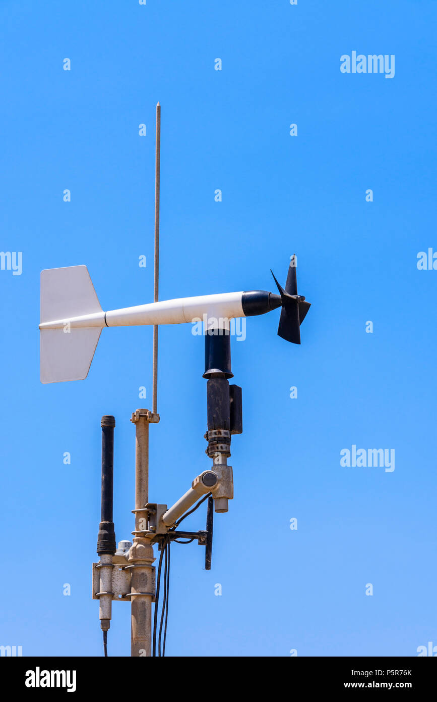 Weather stattion measuring wind speed and direction, temperature and rainfall. - Stock Image