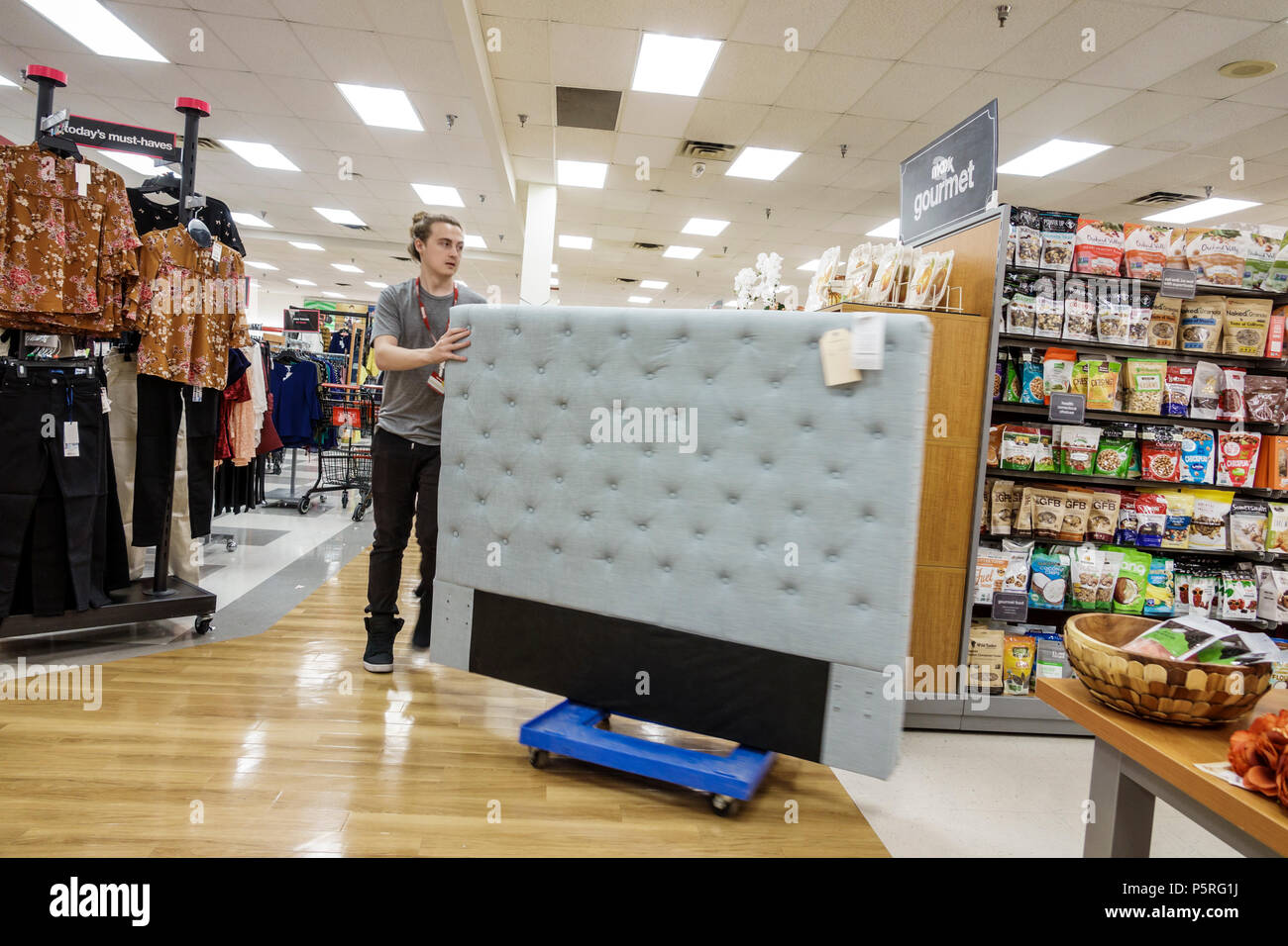 Stuart Florida T.J. TJ Maxx Discount Outlet Department Store Interior  Display Sale Padded Bed Headboard Stock Clerk Moving Furniture Man Employee  Young ...