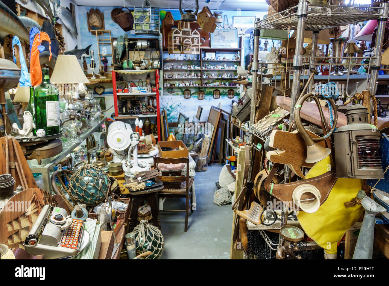 Stuart Florida Crow's Nest Antiques Nautical shopping marine souvenirs cluttered messy shelves display sale - Stock Image