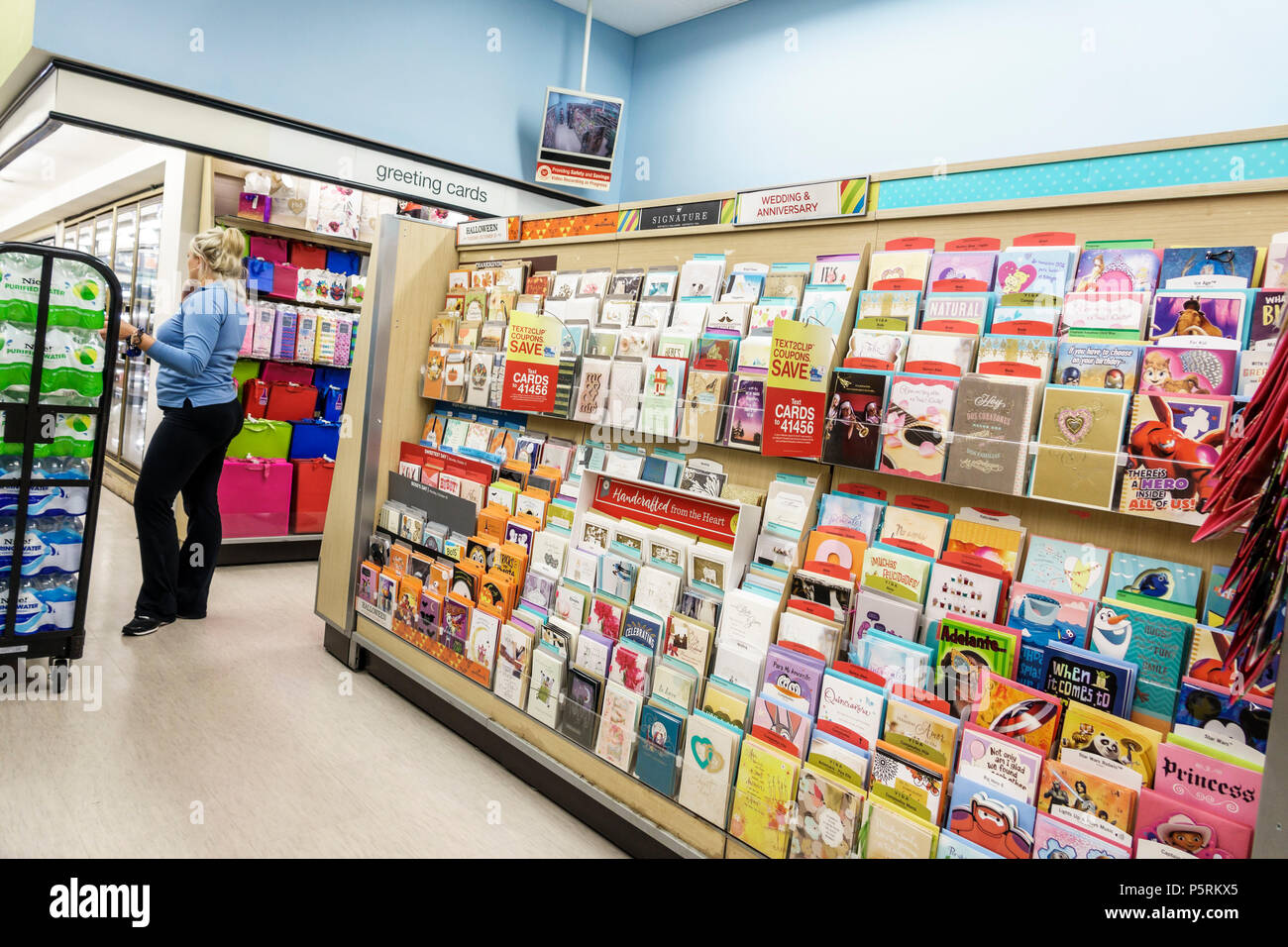 Miami beach florida walgreens pharmacy drugstore interior shopping miami beach florida walgreens pharmacy drugstore interior shopping stationery greeting cards woman worker stock clerk employee display sale m4hsunfo