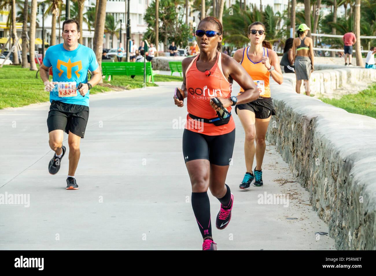 Miami Beach Florida Ocean Drive Lummus Park Burger King 5K Beach Run fundraiser corporate sponsor Black woman man runners running race sport competiti - Stock Image