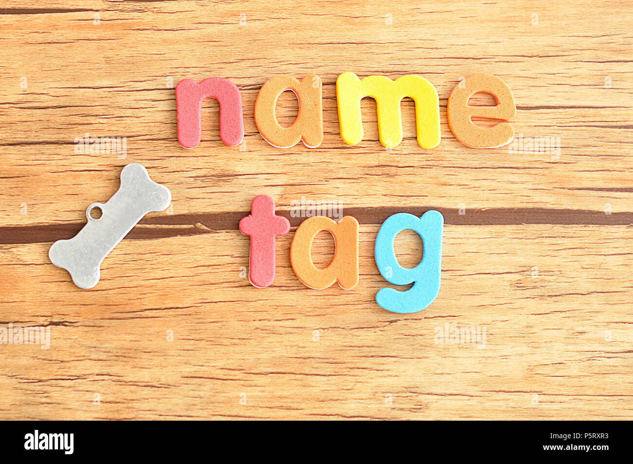 A bone shape name tag for a dog with the word name tag Stock Photo