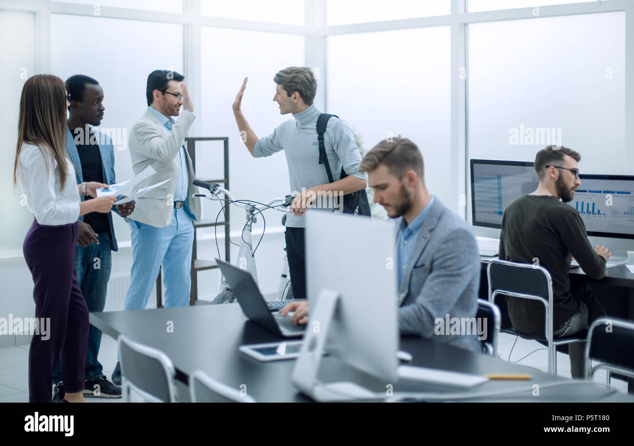 business team at workplace in office - Stock Image
