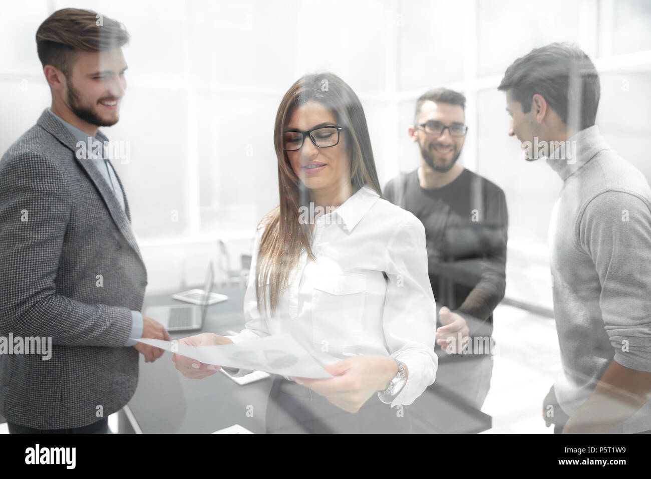 behind the glass.business team discusses working documents - Stock Image