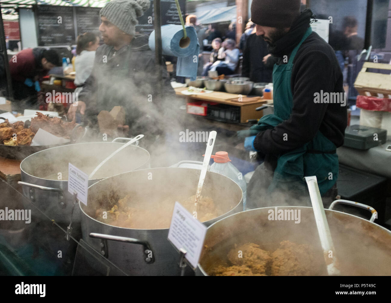 Delicious Steaming hot street food, Variety of Curries the weekly Broadway Street Market, Hackney, London, England, Europe. Stock Photo