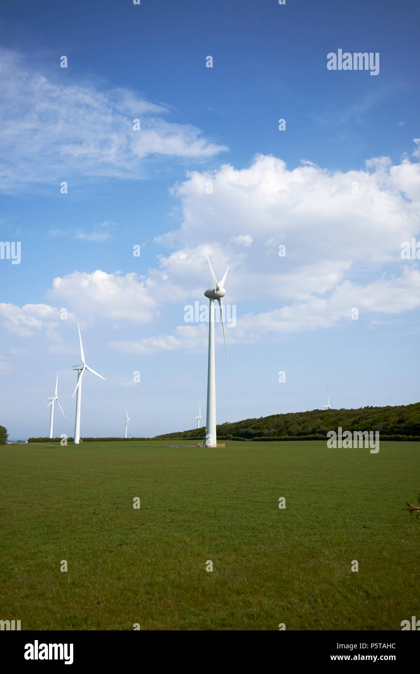 wind turbines on farmland in the lake district near whitehaven Cumbria England UK - Stock Image