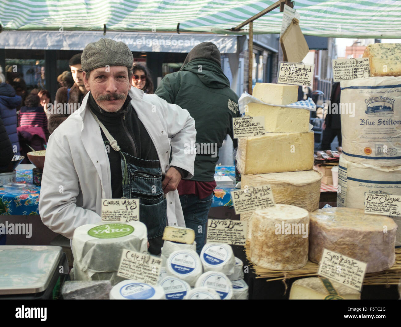 Charming Moustached Man Selling a Variety of Handmade Artisan Cheeses at Broadway Market in Hackney, London, England, Europe. Stock Photo