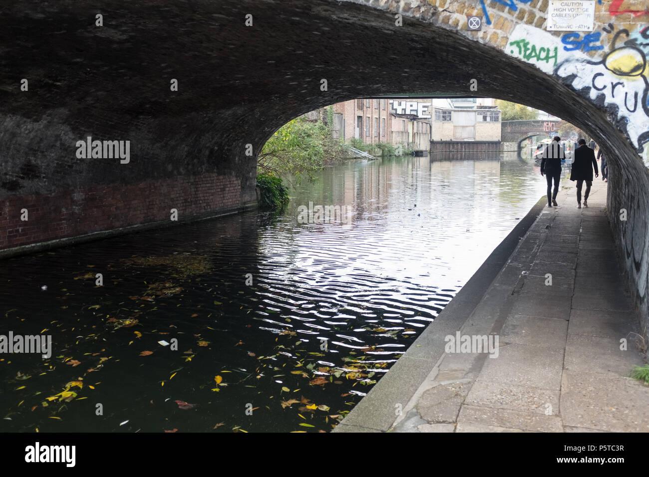 People Walking Under Tunnel Alongside Canal, Hackney, London, England, UK. Stock Photo