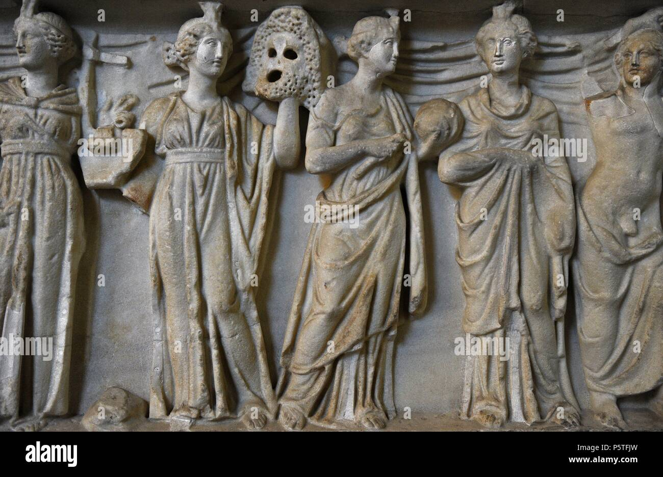 Roman sarcophagus. About 180 AD.  Goddess Athena, God Apollo and the nine Muses (goddesses of the inspiration of literature, science and the arts. Reliefs. Detail. Glyptothek. Munich. Germany. - Stock Image