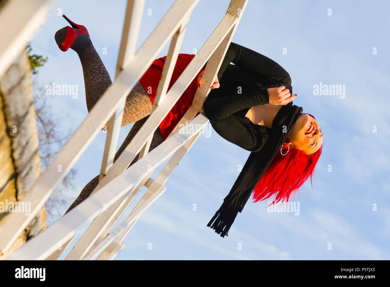 Red haired adult girl dots dot pattern patterned tights Stock Photo