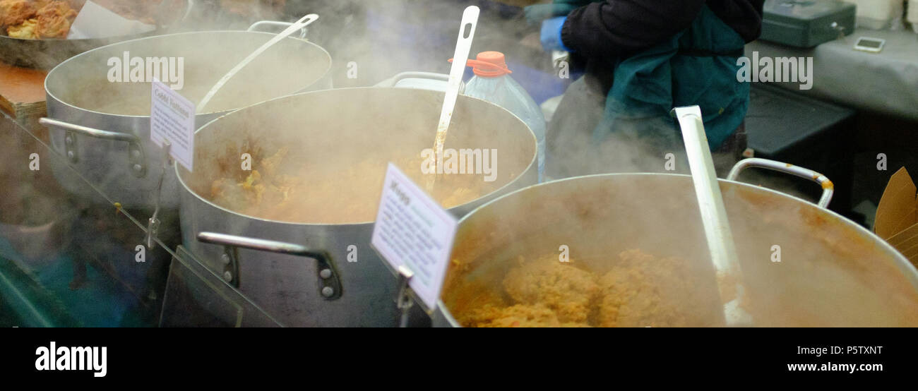 Delicious Steaming hot street food at the weekly Broadway Street Market, Hackney, London, England, Europe. - Stock Image