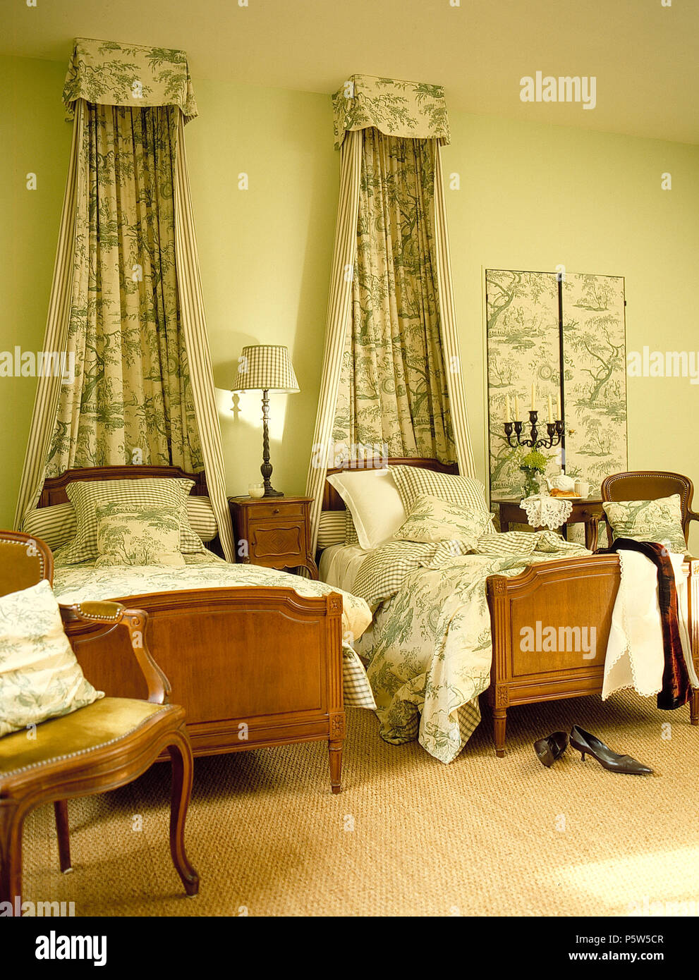 Green Toile De Jouy Canopy And Drapes Above Twin Beds With Matching Toile Quilts In French Country Bedroom Stock Photo Alamy