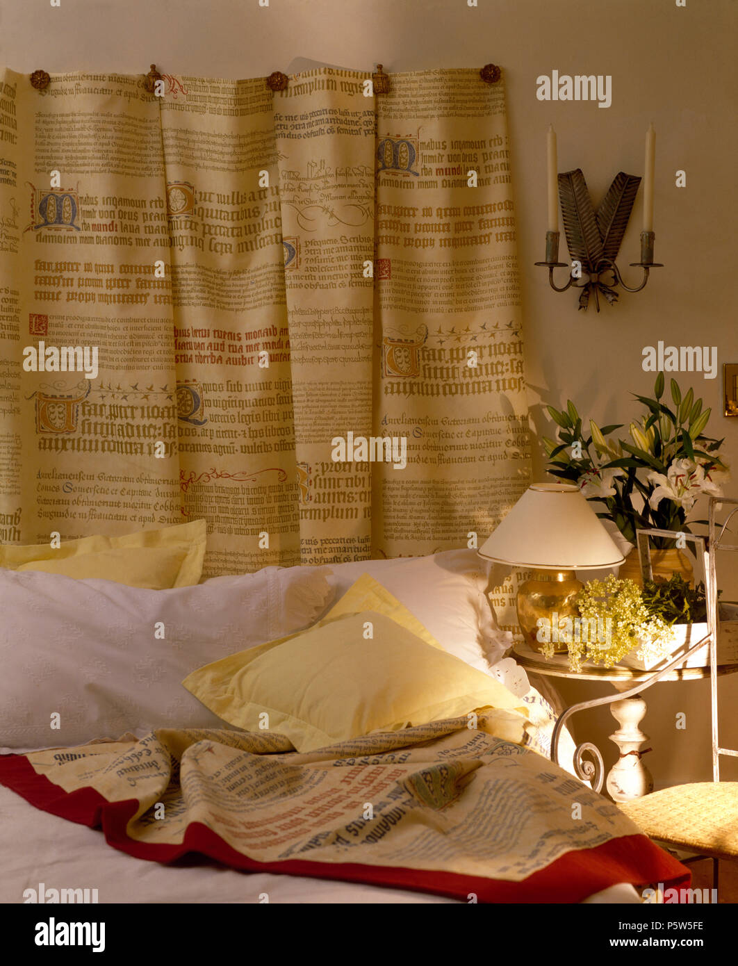 Hand Lettered Hanging On Wall Above Bed In An Economy Style Bedroom Stock Photo Alamy