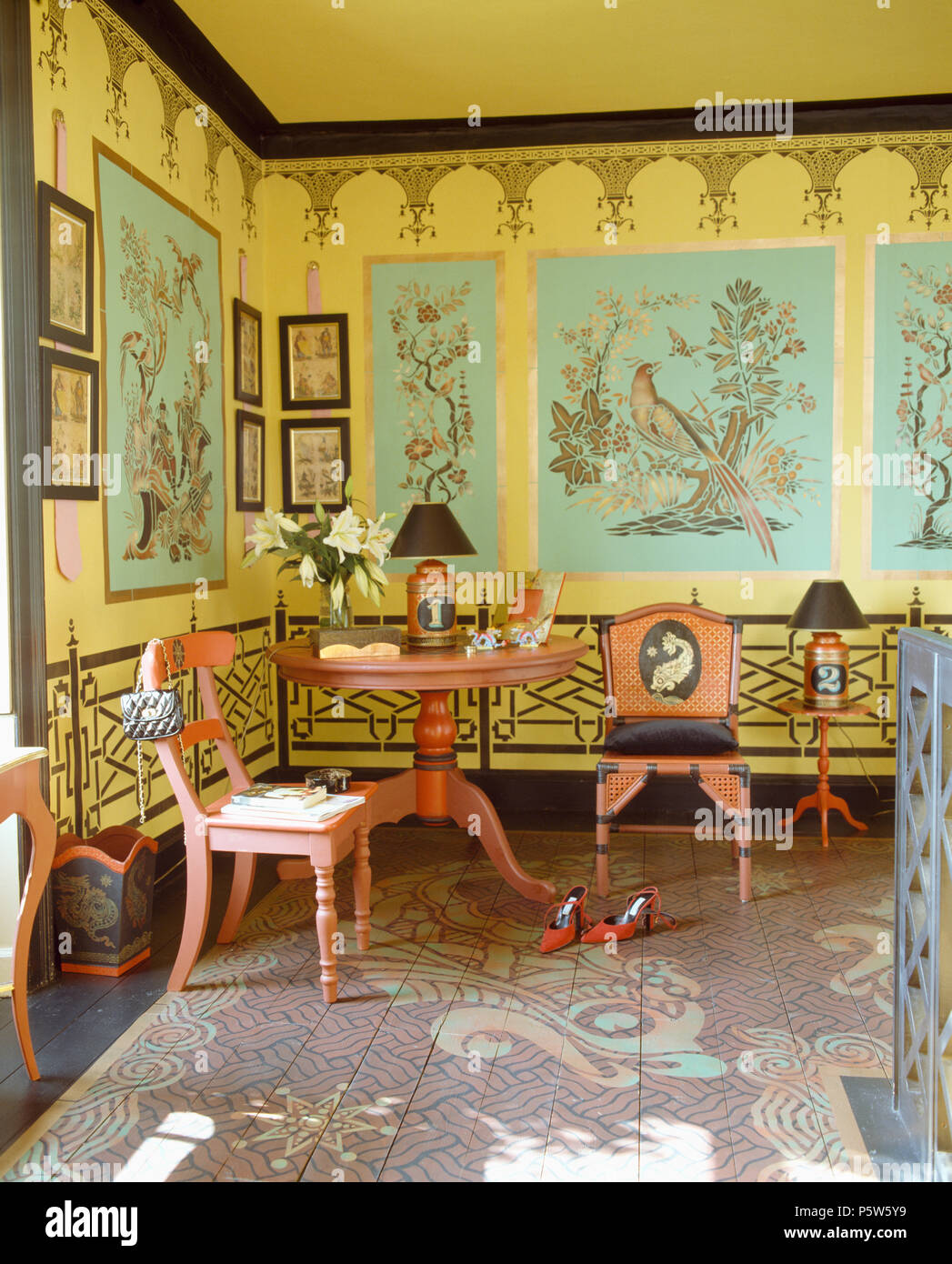 Walls stenciled with Chinese-style birds in bedroom with red painted ...