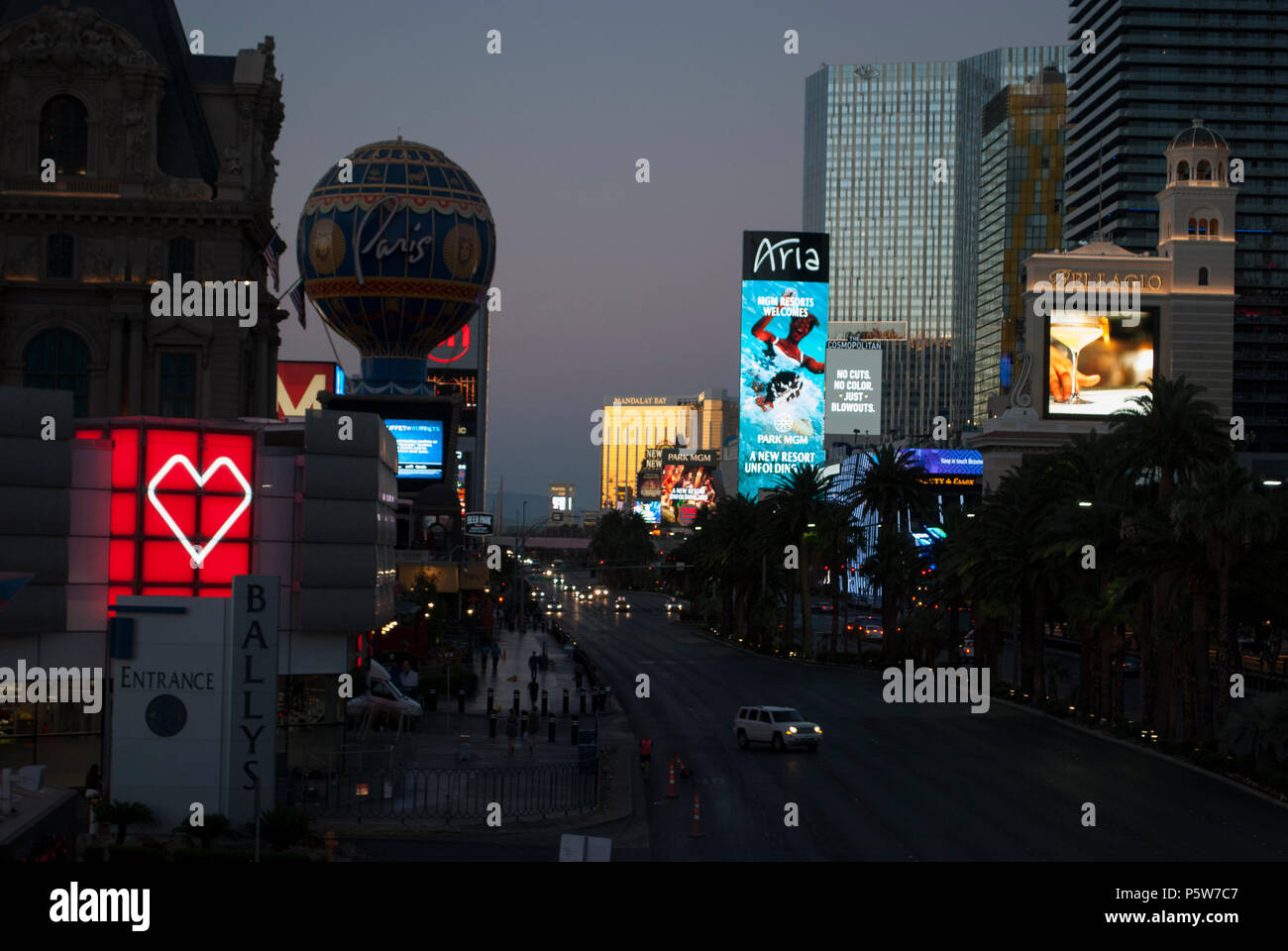 Famous city. Modern urban style. Advertising billboards, neon lights. Las Vegas Strip at night. Early morning at the Strip - Stock Image