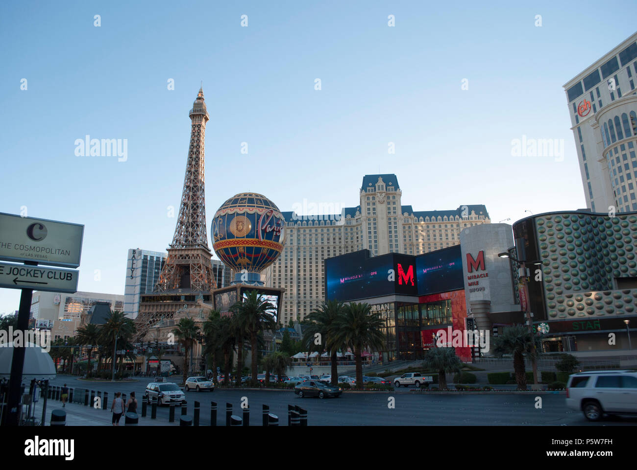 Famous city.  Advertising billboards, neon lights. Hollywood, Paris, Las Vegas, Strip. Famous street. Sunrise. Sunset in the city - Stock Image
