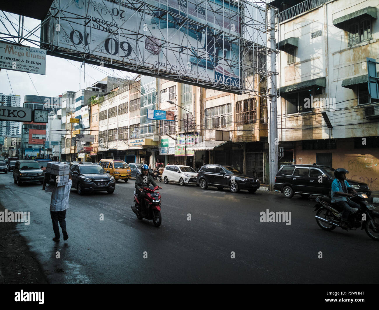 Afternoon urban street scene in Medan, Sumatra, Indonesia - Stock Image