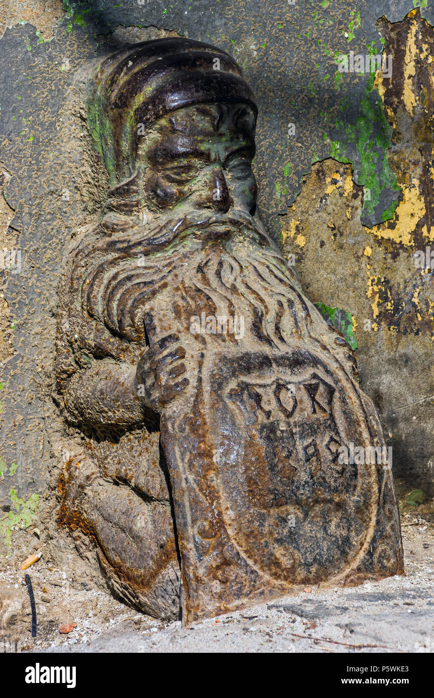 Warsaw, Poland - May 31st, 2018: Cast iron dwarf or gate stop at a 19th-century tenement building on Prozna Street. Stock Photo