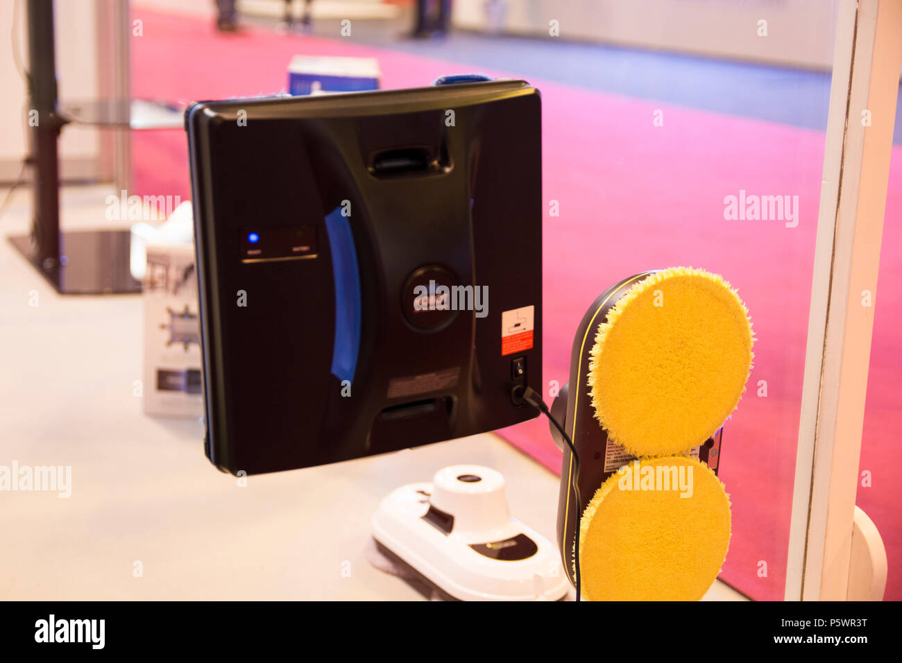 HOBOT 288 Window cleaner robot from Smartbot company, cleanning an office window  in GR-EX (Global Robot Expo). - Stock Image