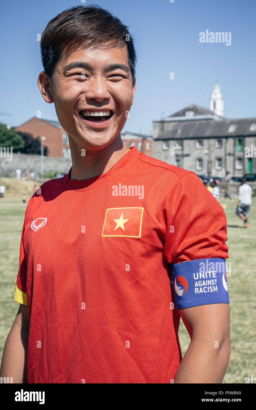A portrait of a young footballer wearing Unite Against Racism armband. - Stock Image