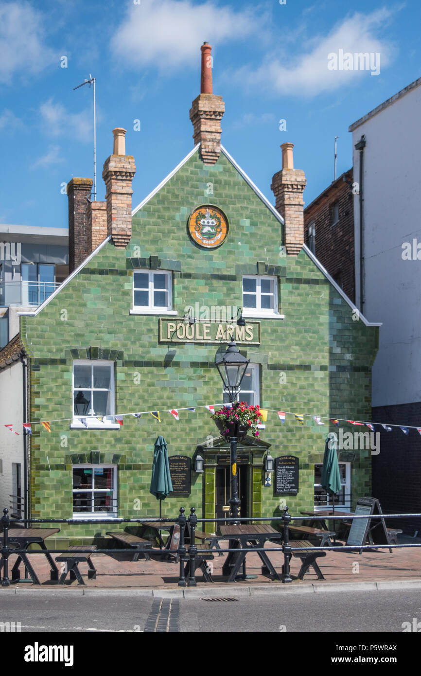 The Front green tiled facade of the Poole Arms Public House on the quayside in Poole Dorset on a sunny summers day. - Stock Image